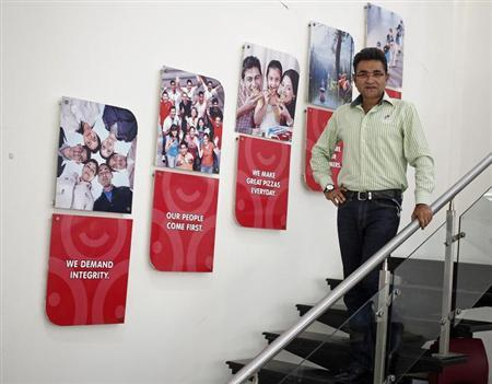 Jubilant Foodworks CEO Ajay Kaul poses for a photo inside his office premises at Greater Noida on the outskirts of New Delhi September 11, 2013. REUTERS/Anindito Mukherjee