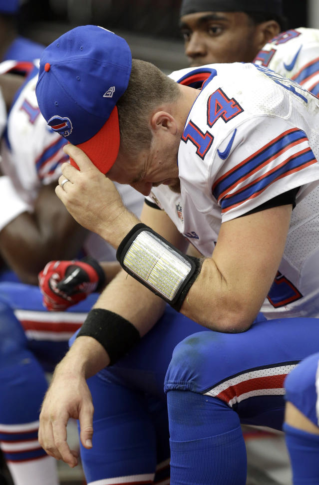 Buffalo Bills quarterback Ryan Fitzpatrick (14) sits on the bench after fumbling the ball in the fourth quarter of an NFL football game against the Houston Texans, Sunday, Nov. 4, 2012, in Houston. Houston recovered the fumble and defeated the Bills 21-9. (AP Photo/Eric Gay)