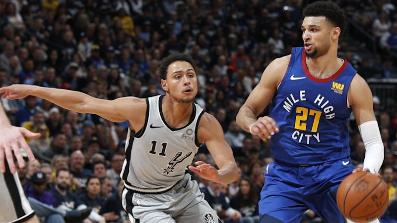 Murray's big fourth lifts Nuggets past Spurs to even series