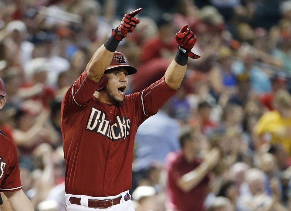 Arizona Diamondbacks' David Peralta shouts in celebration to teammate Chris Owings after Owings hit a run-scoring single against the Atlanta Braves during the seventh inning of a baseball game Wednesday, June 3, 2015, in Phoenix. (AP Photo/Ross D. Franklin)