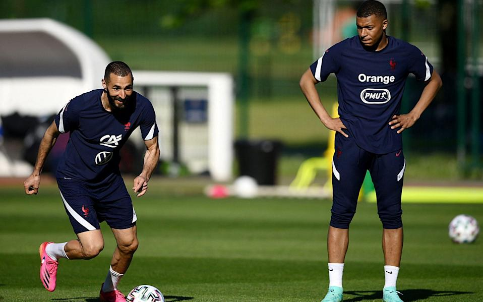 Karim Benzema (left) makes his return to the national squad - AFP