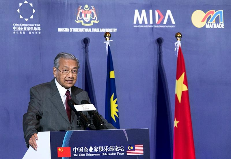 Tun Dr Mahathir Mohamad says the East Coast Rail Link and other projects awarded to Chinese firms are cancelled as China's President Xi Jinping has agreed with Malaysia's stand. — Reuters pic