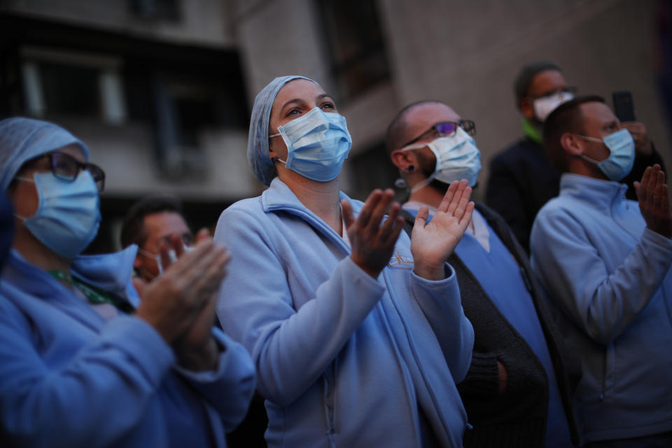 Medical personnel shout slogans during a protest outside Chirec hospital in Braine-l'Alleud, near Brussels, Belgium, Thursday, Nov. 5, 2020. COVID-19 coronavirus cases have surged around Europe in recent weeks, putting fresh pressure on overworked medical staff and hospitals, and forcing several countries to impose tough new movement restrictions. (AP Photo/Francisco Seco)
