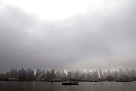 New York police divers search Hudson River for missing swimmer