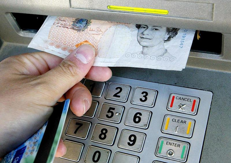 A person using an ATM. Photo: Gareth Fuller/PA Wire/PA Images