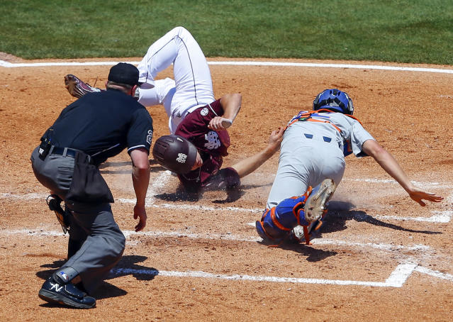 <p>Mississippi State's Hunter Vansau (32) is tagged out by Florida catcher JJ Schwarz (22) as he slides into home plate during the fourth inning of the Southeastern Conference NCAA college baseball tournament, Friday, May 26, 2017, in Hoover, Ala. (Photo: Butch Dill/AP) </p>