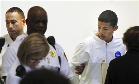 Philip Chism stands during his arraignment for the death of Danvers High School teacher Colleen Ritzer in Salem District Court in Boston
