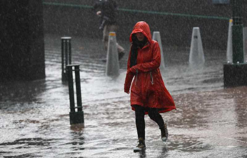 Pedestrians are seen in the rain on Southbank in Melbourne.
