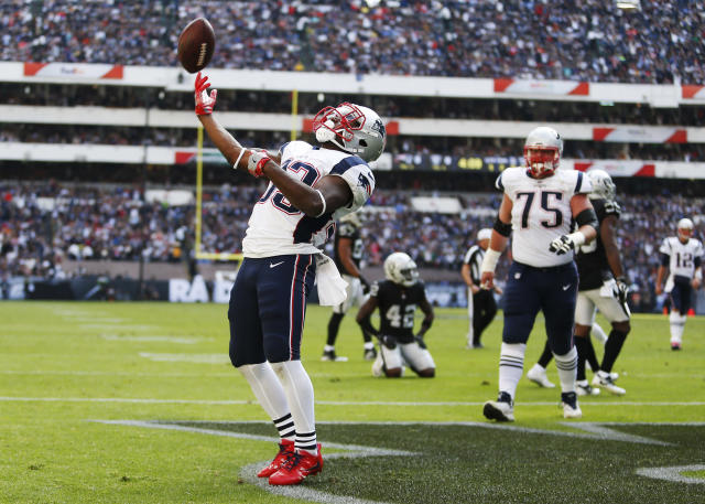 <p>New England Patriots Dion Lewis celebrates after scoring a touchdown against the Oakland Raiders during the first half of their 2017 NFL Mexico Game at the Estadio Azteca in Mexico City, Nov. 19, 2017. (Photo by Jessica Rinaldi/The Boston Globe via Getty Images) </p>
