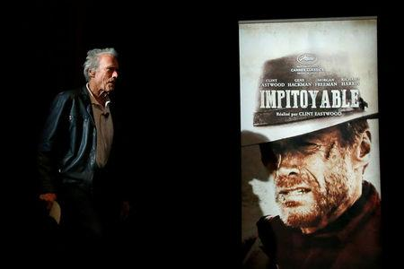 """70th Cannes Film Festival - Cinema Masterclass - Cannes, France. 21/05/2017. Director Clint Eastwood walks past a poster of his film """"Unforgiven"""" (Impitoyable) as he arrives. REUTERS/Stephane Mahe     TPX IMAGES OF THE DAY"""