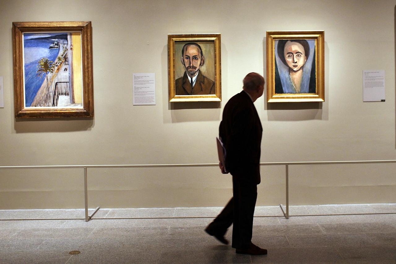"NEW YORK, NY - FEBRUARY 22: A man walks through a preview of ""The Steins Collect: Matisse, Picasso, and the Parisian Avant-Garde"" at the Metropolitan Museum of Art on February 22, 2012 in New York City. The new exhibition, which focuses on the collections of Gertrude Stein and her brothers, Leo and Michael and Michael's wife, Sarah and will be shown until June 3, 2012, features works by Paul Cezanne, Edgar Degas, Paul Gauguin, Henri de Toulouse-Lautrec, Edouard Manet, and Auguste Renoir. The Steins were major patrons of modern art in Paris during the first decades of the twentieth century. (Photo by Spencer Platt/Getty Images)"