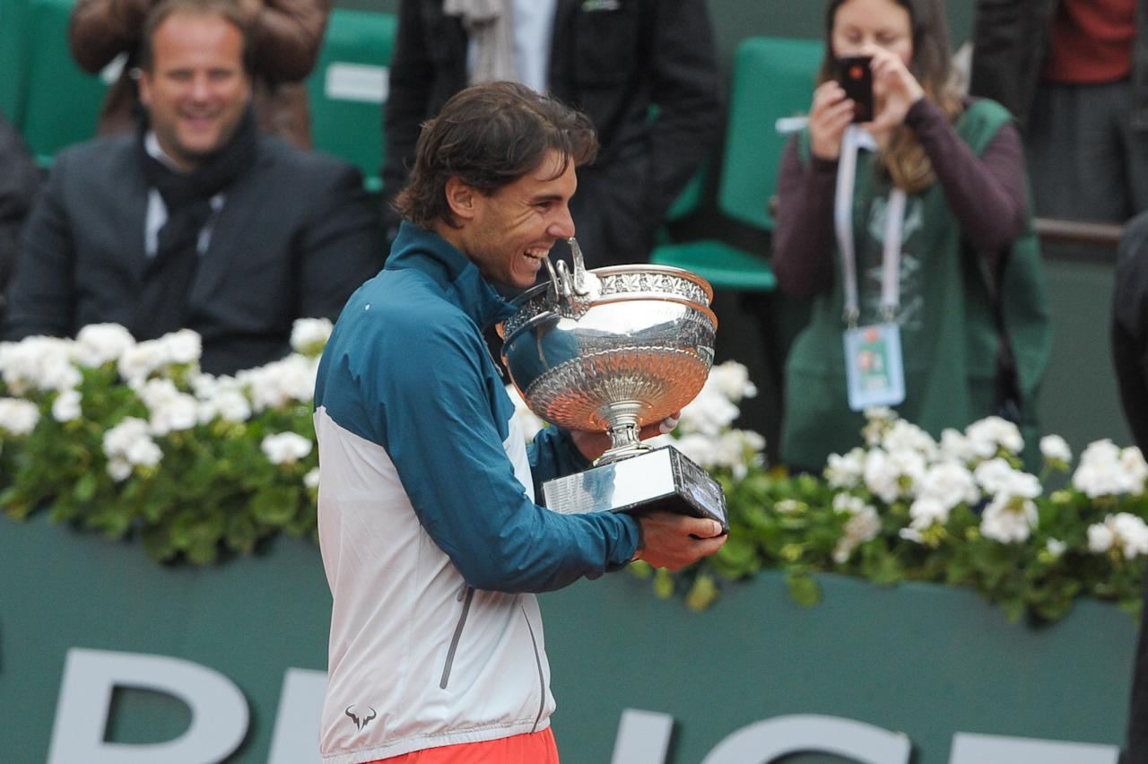 PARIS, FRANCE - JUNE 09:  Rafael Nadal poses with the trophy of Musketeers after he wins the french open 2013 at Roland Garros on June 9, 2013 in Paris, France.  (Photo by Rindoff/Charriau/WireImage)