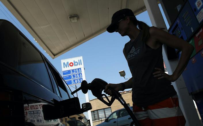 "<span class=""caption"">ExxonMobil is one of many companies that will likely spend a lot of money on upcoming elections.</span> <span class=""attribution""><a class=""link rapid-noclick-resp"" href=""https://www.gettyimages.com/detail/news-photo/anastasia-hinchsliff-fuels-her-suv-at-an-exxon-mobile-gas-news-photo/103157613?adppopup=true"" rel=""nofollow noopener"" target=""_blank"" data-ylk=""slk:John Gress/Getty Images"">John Gress/Getty Images</a></span>"
