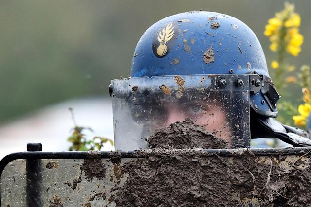 <p>A French gendarme stands behind a riot shield during a clash with ZAD activists to clear an area known as ZAD (Zone a Defendre – Zone to defend) of environmental protesters occupying the site of what had been a proposed new airport in Notre dame des Landes on April 9, 2018. (Photo: Loic Venance/AFP/Getty Images) </p>
