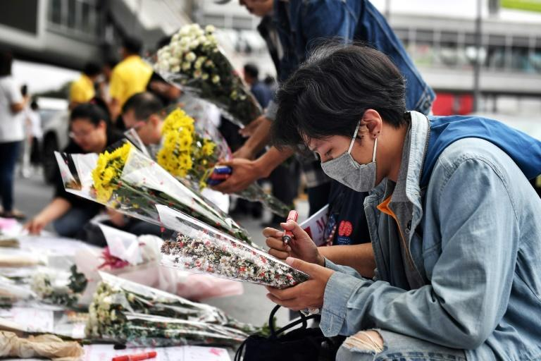 Mourners lay flowers at the Terminal 21 shopping mall, where a mass shooting took place, in the Thai northeastern city of Nakhon Ratchasima