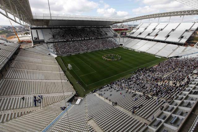 A general view is seen of the Arena de Sao Paulo Stadium, one of the venues for the 2014 World Cup, before a soccer match test in the Sao Paulo district of Itaquera May 10, 2014. The stadium will host the opening match of the 2014 World Cup. REUTERS/Paulo Whitaker (BRAZIL - Tags: SPORT SOCCER WORLD CUP)