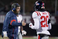 In this Nov. 28, 2019 photo, Mississippi head coach Matt Luke reaches out to Mississippi defensive back Keidron Smith (20) following a second half play during an NCAA college football game against Mississippi State, in Starkville, Miss. Mississippi has fired Luke, three days after his third non-winning season ended with an excruciating rivalry game loss. Athletic director Keith Carter said Sunday, Dec. 1, 2019 the decision to change coaches was made after evaluating the trajectory of the program and not seeing enough momentum on the field. (AP Photo/Rogelio V. Solis)