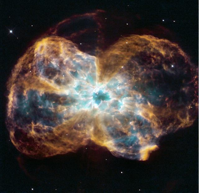 A burned-out star, called a white dwarf, is the white dot in the center in this Hubble Space Telescope image (HST)