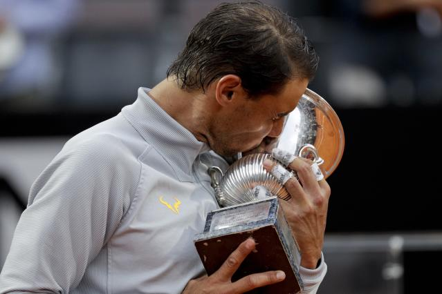Spain's Rafael Nadal kisses the trophy after beating Germany's Alexander Zverev in the final match of the Italian Open tennis tournament, in Rome, Sunday, May 20, 2018. Nadal won 6-1, 1-6, 6-3. (AP Photo/Gregorio Borgia)