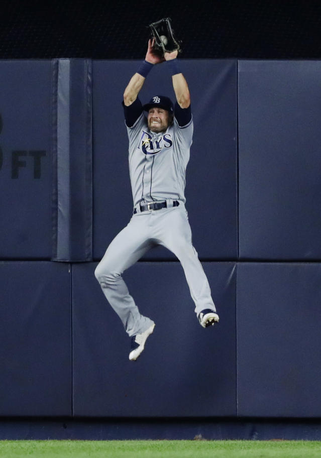 Tampa Bay Rays center fielder Kevin Kiermaier catches a ball hit by New York Yankees' Miguel Andujar for an out during the fourth inning of a baseball game Wednesday, Aug. 15, 2018, in New York. (AP Photo/Frank Franklin II)