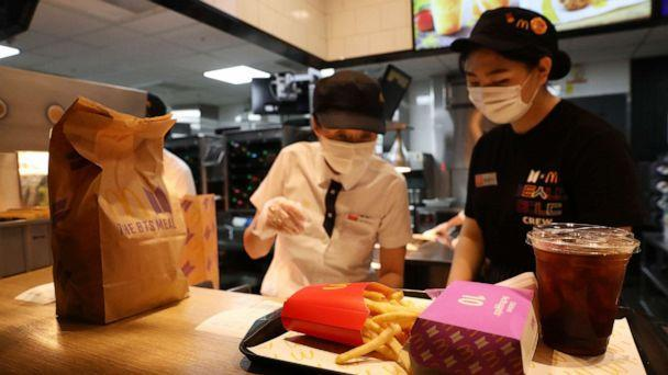 PHOTO: Employees of McDonald's serve a BTS meal on May 27, 2021 in Seoul, South Korea. (Chung Sung-jun/Getty Images, FILE)