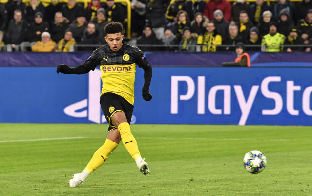 Dortmund's Jadon Sancho scores the opening goal during the Champions League Group F soccer match between Borussia Dortmund and Slavia Praha in Dortmund, Germany, Tuesday, Dec. 10, 2019. (AP Photo/Martin Meissner)