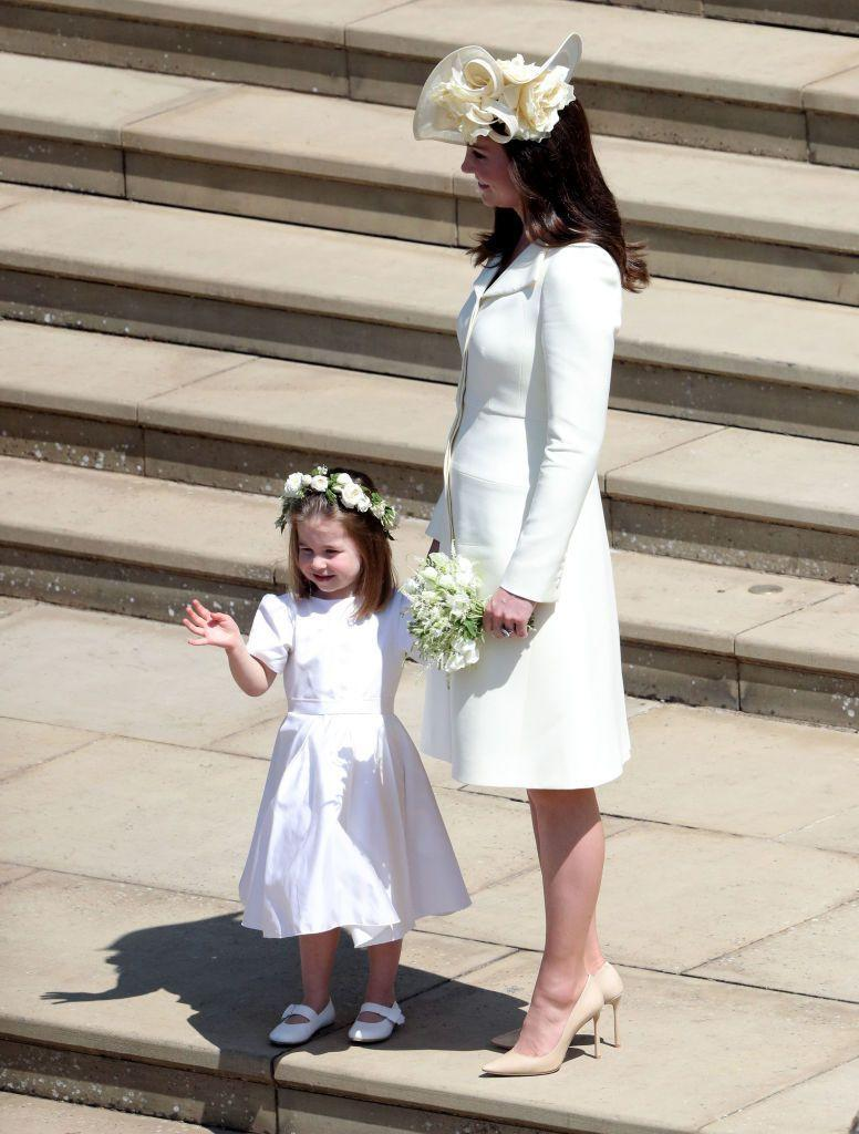 """<p>The Duchess of Cambridge <a href=""""https://www.townandcountrymag.com/style/fashion-trends/a14522426/kate-middleton-dress-prince-harry-meghan-markle-wedding/"""" rel=""""nofollow noopener"""" target=""""_blank"""" data-ylk=""""slk:wore a yellow wool silk tailored coat"""" class=""""link rapid-noclick-resp"""">wore a yellow wool silk tailored coat</a> by Alexander McQueen to Prince Harry and Meghan Markle's wedding.</p>"""
