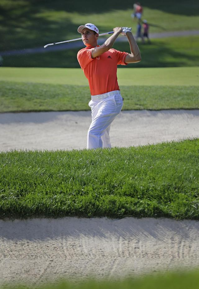 Oliver Goss, of Australia, hits out of a sand trap on the 16th hole during the third round of the Quicken Loans National PGA golf tournament, Saturday, June 28, 2014, in Bethesda, Md. (AP Photo/Patrick Semansky)