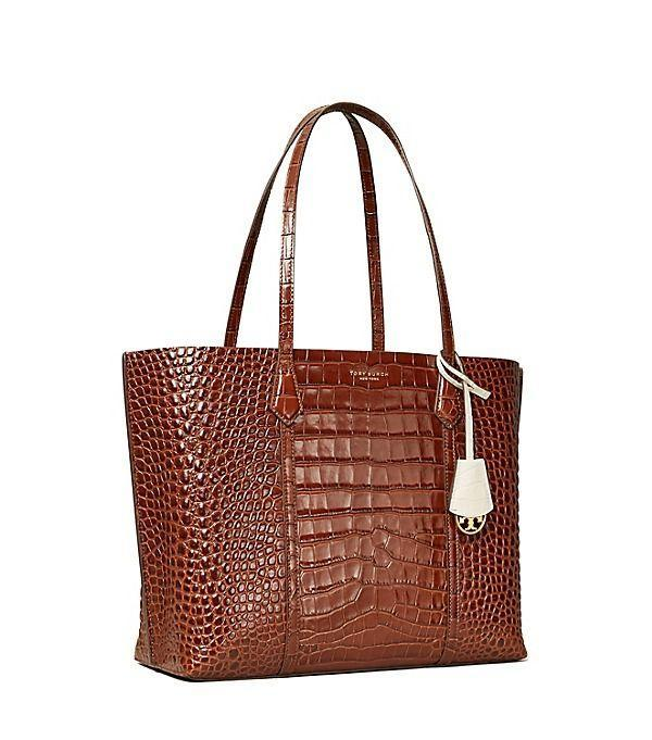 """<p><strong>Tory Burch</strong></p><p>toryburch.com</p><p><a href=""""https://go.redirectingat.com?id=74968X1596630&url=https%3A%2F%2Fwww.toryburch.com%2Fperry-embossed-triple-compartment-tote-bag%2F73619.html&sref=https%3A%2F%2Fwww.townandcountrymag.com%2Fstyle%2Ffashion-trends%2Fg36755206%2Ftory-burchs-semi-annual-sale-june-2021%2F"""" rel=""""nofollow noopener"""" target=""""_blank"""" data-ylk=""""slk:Shop Now"""" class=""""link rapid-noclick-resp"""">Shop Now</a></p><p><strong><del>$478</del> $247 (48% off)</strong></p><p>Stay organized and on top of things with this croc-embossed tote. Thanks to the three designated compartments, there's plenty of room for your laptop, wallet, and important papers.</p>"""