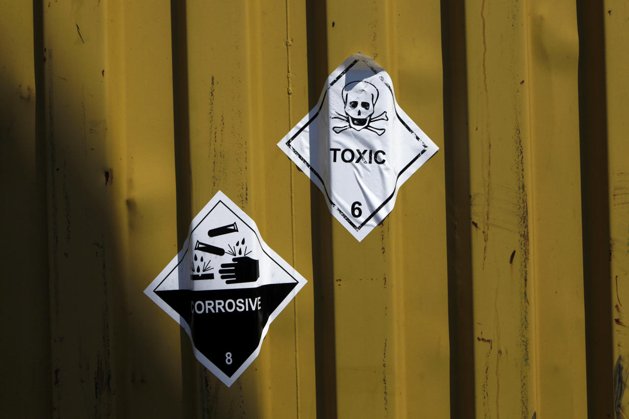 "In this Tuesday, May 13, 2014 file photo, signs reading ""Toxic"" are seen on the containers carrying Syria's dangerous chemical weapons aboard the Danish cargo ship, Ark Futura, transporting the chemical weapons out of the strife-torn country, in Cyprus coastal waters. Organization for the Prohibition of Chemical Weapons director general Ahmet Uzumcu said Monday, June 23, 2014, the final shipment of stockpiled chemical weapons has been loaded onto Danish and Norwegian ships for transportation out of Syria.(AP Photo/Petros Karadjias, File)"