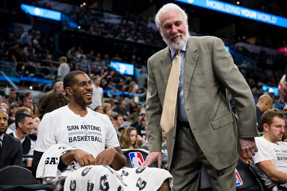 LaMarcus Aldridge and Gregg Popovich get on the same page. (AP)