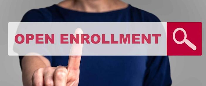 Person holding finger out, reaching it towards a search bar imposed over their body that says Open Enrollment