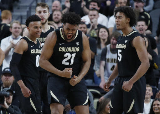 Colorado's Evan Battey (21) celebrates after scoring against Oregon State during the second half of an NCAA college basketball game in the quarterfinals of the Pac-12 men's tournament Thursday, March 14, 2019, in Las Vegas. (AP Photo/John Locher)