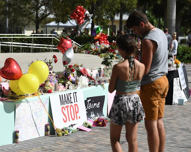 The community gathers to pay its respects to the shooting victims at Marjory Stoneman Douglas High School in Parkland, Fla. (Photo: mpi04/MediaPunch/IPX)