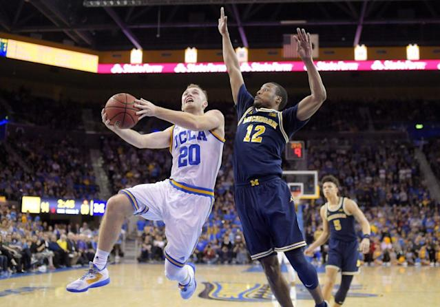 "<a class=""link rapid-noclick-resp"" href=""/ncaab/players/120693/"" data-ylk=""slk:Bryce Alford"">Bryce Alford</a> helped UCLA torch Michigan for 102 points Saturday night (AP)"