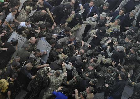 Members of Ukraine's State Security Administration clash with members of the Euromaidan movement's self-defence units during a rally outside the cabinet of ministers building in Kiev