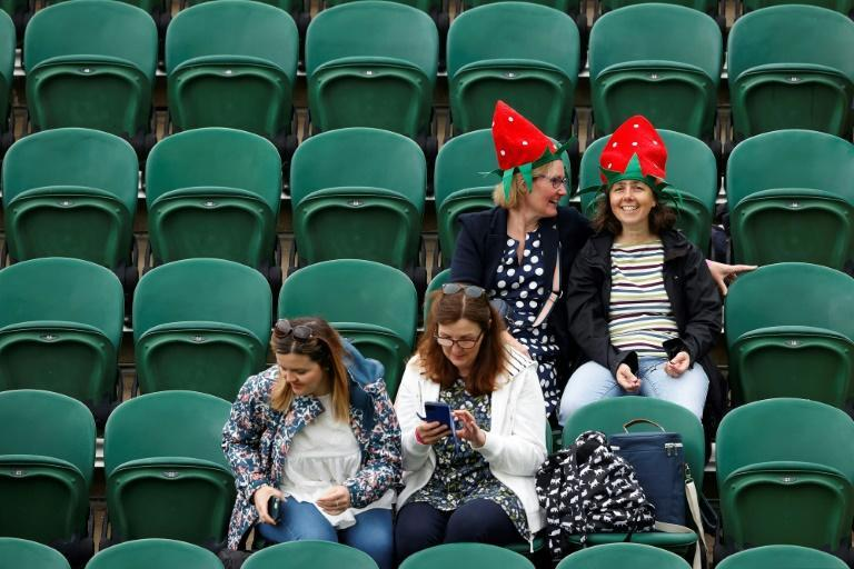 Spectators returned to Wimbledon like the Grand Slam itself after a year's hiatus due to the coronavirus pandemic with half the usual capacity e permitted and obliged to wear masks walking round the grounds but can remove them courtside