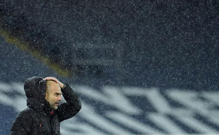 Pep Guardiola is soaked on the sidelines as Storm Bella battered the Etihad during Manchester City's win over Newcastle