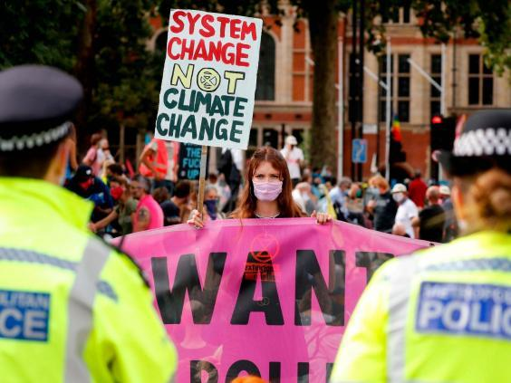 A young activist holds a placard at Parliament Square (AFP/Getty)