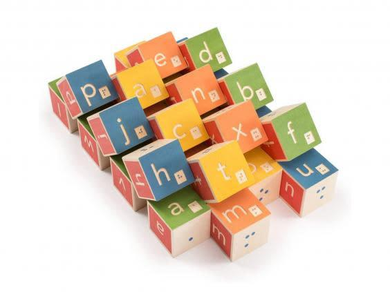 Use these blocks to teach them braille, which will be an essential way to navigate through everyday situations as they get older (Amazon)