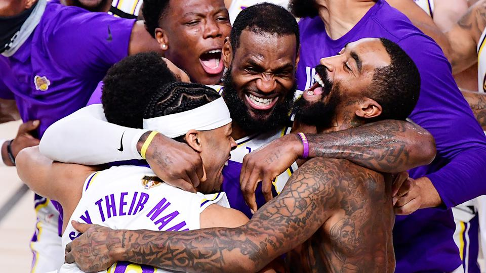 LeBron James and his Lakers teammates celebrate after defeating the Miami Heat in the NBA Finals. (Photo by Douglas P. DeFelice/Getty Images)