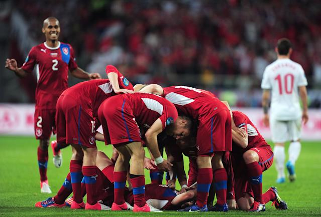 WROCLAW, POLAND - JUNE 16: Petr Jiracek of Czech Republic celebrates scoring the first goal with team mates during the UEFA EURO 2012 group A match between Czech Republic and Poland at The Municipal Stadium on June 16, 2012 in Wroclaw, Poland. (Photo by Jamie McDonald/Getty Images)