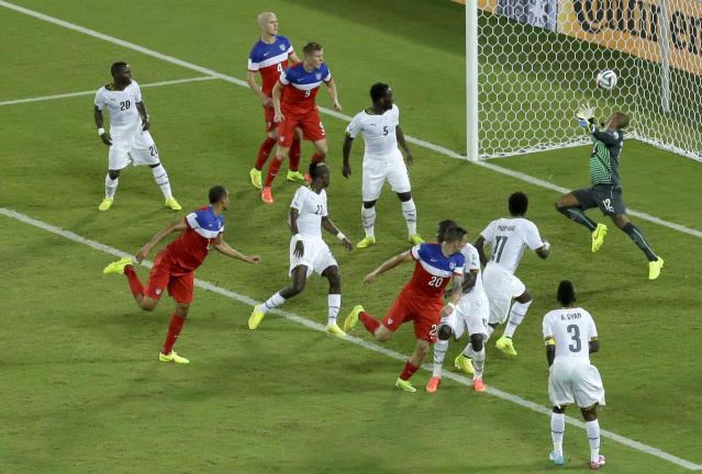 United States' John Brooks, second from left, scores his side's second goal during the group G World Cup soccer match between Ghana and the United States at the Arena das Dunas in Natal, Brazil, Monday, June 16, 2014. The United States defeated Ghana 2-1.(AP Photo/Hassan Ammar)