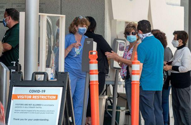 PHOTO: People wearing masks wait to enter to the Jackson Memorial Hospital in Miami, June 22, 2020. (Cristobal Herrera/EPA via Shutterstock, FILE)