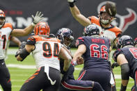 Houston Texans quarterback Deshaun Watson (4) fumbles the football as he is hit by Cincinnati Bengals' Sam Hubbard (94) during the second half of an NFL football game Sunday, Dec. 27, 2020, in Houston. The Bengals recovered the fumble and beat the Texans 37-31. (AP Photo/Eric Christian Smith)