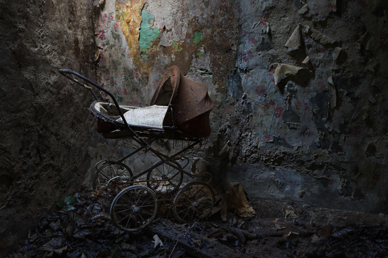 A pram inside an abandoned home in Northern Ireland. These haunting images capture abandoned homes across Northern Ireland. (Photo: Unseen Decay/Mercury Press/Caters News)
