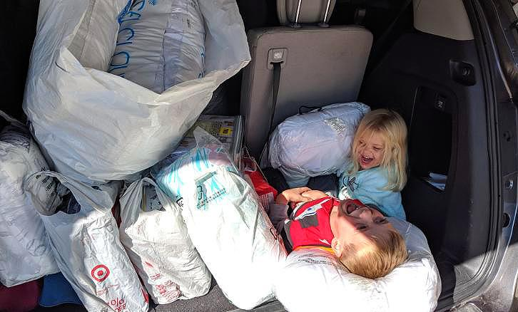 Tyler Sliz and his sister Addison with bedding supplies in their car trunk   Jackie Sliz