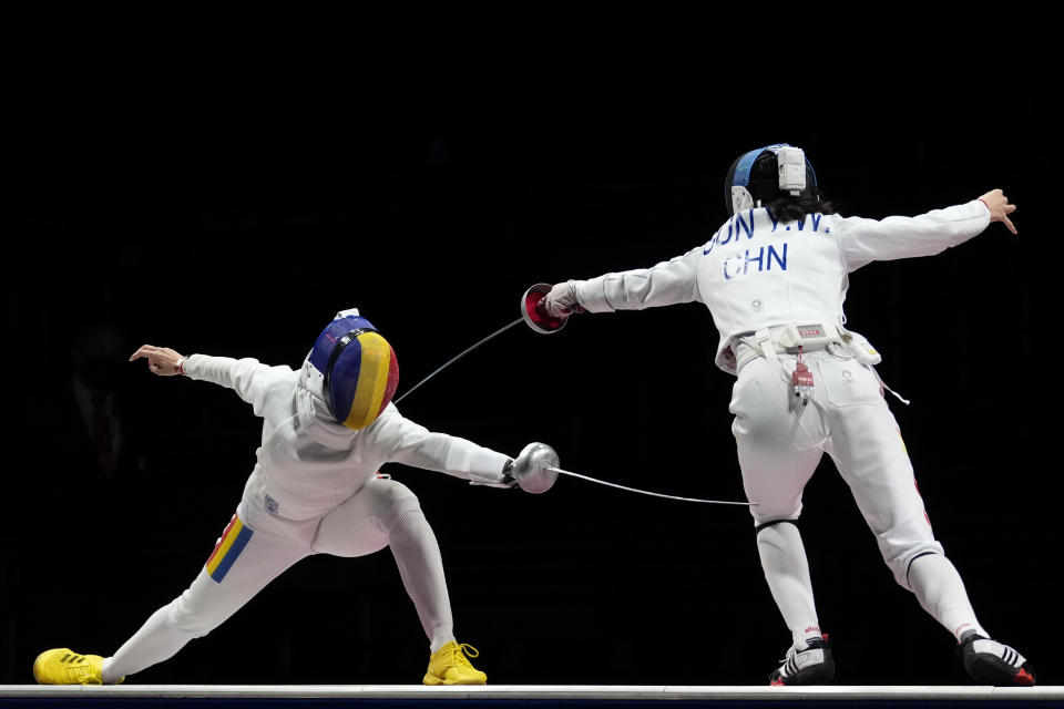 Ana Maria Popescu of Romenia, left, and Sun Yiwen of China compete in the women's individual Epee final competition at the 2020 Summer Olympics, Saturday, July 24, 2021, in Chiba, Japan. (AP Photo/Andrew Medichini)
