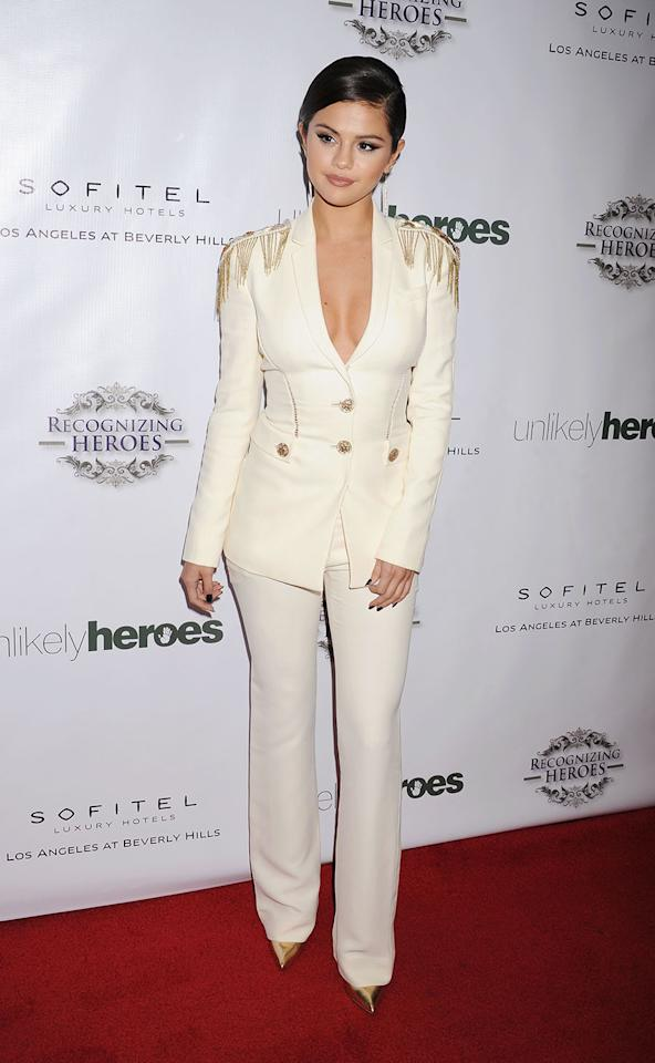 <p>Selena Gomez added some gold details to her cream suit at the 3rd Annual Unlikely Heroes Awards Dinner and Gala at the Sofitel Hotel in 2014 in Los Angeles. (Photo: Jeffrey Mayer/WireImage) </p>
