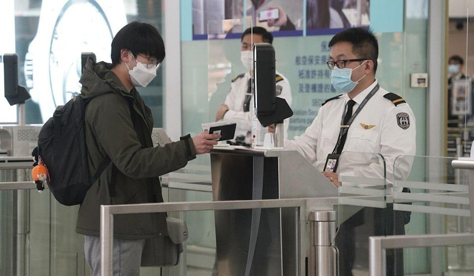 A passenger presents a second piece of identification at Hong Kong International Airport after China said it would no longer recognise the BN(O) passport. Photo: Felix Wong